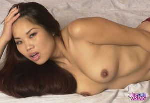 Asian amateur rocks her firm tits and hard nipples before removing her panties