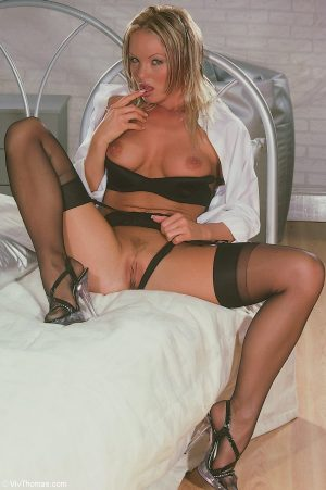Sexy Czech MILF Silvia Saint poses in her black lingerie and strips