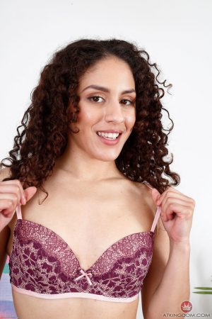 Cute girl with curly hair Liv Aguilera exposes her tasty love holes in a solo