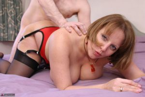 Chubby mature woman Curvy Claire takes a cumshot on her boobs after fucking