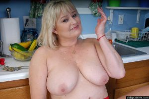 Mature fat lady Lizzy exposing her large saggy tits in kitchen
