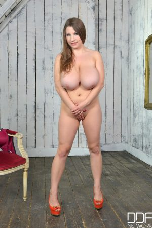 Sexy Russian mom Samanta Lily strips and plays with her enormous natural tits