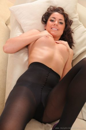 Brunette Gemma Jack goes topless and shows her hot legs in pantyhose