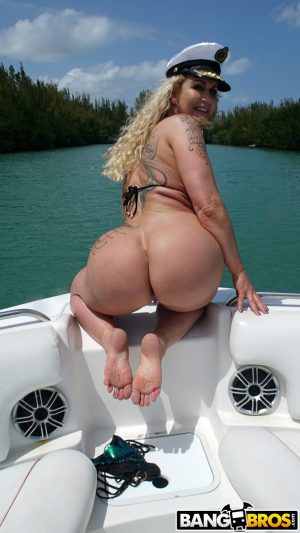 Busty blonde sailor babe Ryan Conner shows off her naked big ass aboard a boat