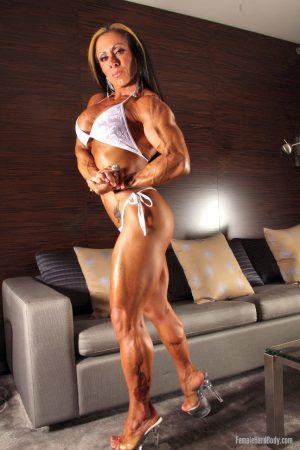 Hot Brazilian bodybuilder Monica Martin poses in her white lingerie & heels