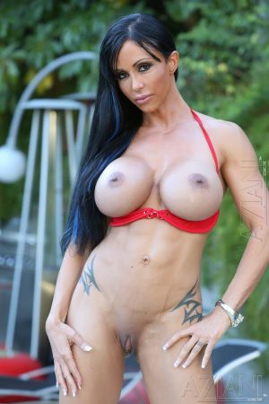 Brunette bodybuilder Jewels Jade exposes her round tits and big clit out back