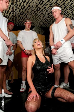 Clothed blonde Sheila B gets her face covered in sperm and warm pee