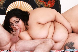 SSBBW Crystal Blue wears her glasses during the course of a hardcore fuck