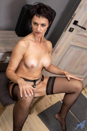 Short haired mature Daryna shows her fakes and masturbates in lingerie