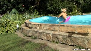 Blonde amateur bares her skinny body to relax while fully naked by the pool