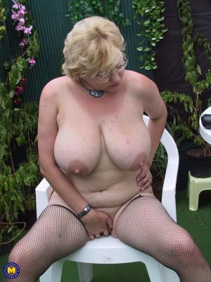 Blonde granny in glasses Valerie reveals her tremendous tits and tastes a dong