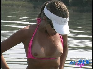 Skilled hottie Lori Anderson strokes her man's dick on a boat & makes him cum