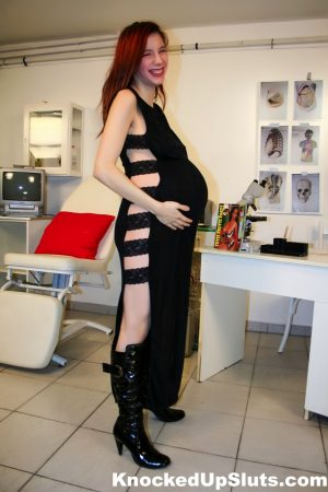 Pregnant redhead gets fucked in the doctor's examination room in boots