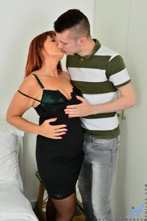 Mature redhead Beau Diamonds cheats on her husband with a young boy