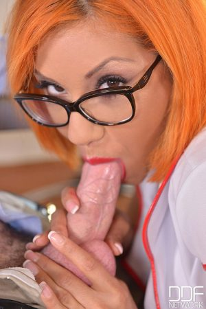 Redhead nurse Rose Valerie sucks and fucks two men at work with her glasses on