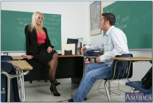 Blonde mature teacher Alexis Golden wears glasses in reality porn show