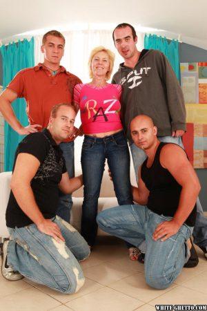 Busty mature blonde Hanela squats for a blowbang at end of a filthy gangbang