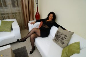 Hot mature woman gives a wicked upskirt and shows her aging ass