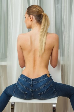 Teen solo girl Kai removes her jeans to display her beautiful face and body