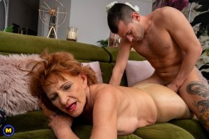 Redheaded nan sports a creampie after sex with her younger lover