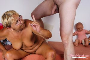 Old granny in glasses Sofia gives a BJ while rubbing her swollen vagina