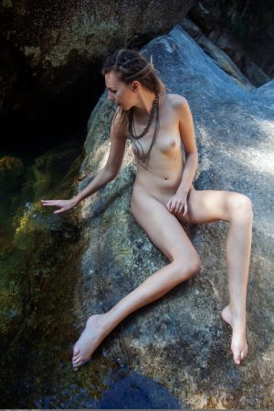 Cutie with dreads Bullet reveals her slender body and poses in a river