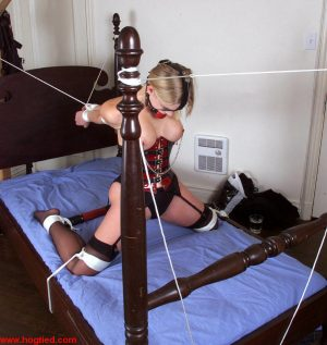 Corseted blonde Rhannion getting her puffy nipples tortured in rope bondage