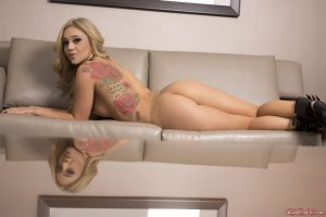 Blond teen Kali Rose shows her back tattoo and perfect ass after getting naked
