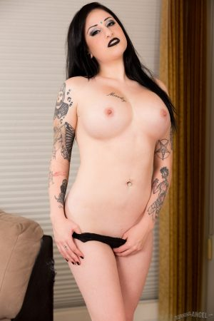 Stunning goth Ophellia Rain sheds hooded dress to expose exquisite big tits