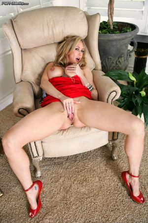 Mature blonde cougar Brandi Love pets shaved pussy & offer up round fake tits
