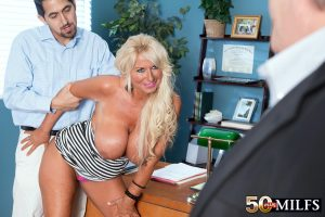 Hot mature woman bangs a younger man while her cuckold husband watches