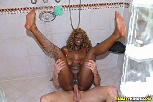 Sexy black whore with huge ass fucking outdoors and in the shower