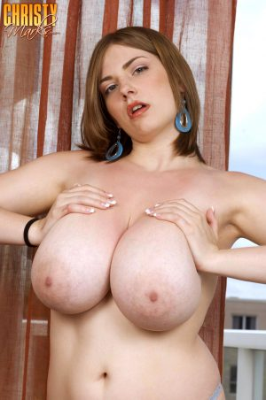Busty smoking woman releases her huge big tits and spreads her shaved pussy