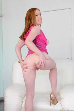 Horny redhead Kierra Wilde flashes her big tits and sweet round ass