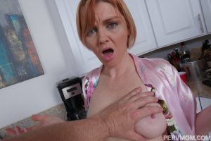 Sexy redhead mom gets caught nude in the kitchen & gets tits groped by stepson