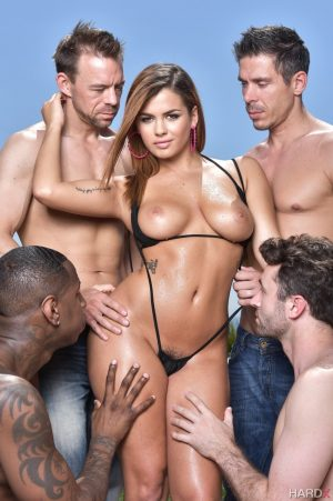 Glamour model Keisha Grey frees her nice tits and ass from V bikini by pool