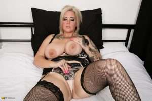 Chubby blonde housewife with large saggy breasts rocks the suicide girl look