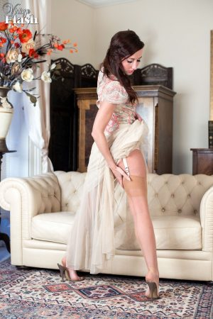 Solo model Sophia Smith removes long dress wearing vintage lingerie and nylons