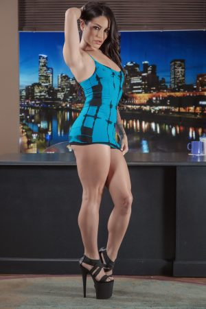 Sizzling pornstar Kissa Sins poses in her tight dress & heels before stripping