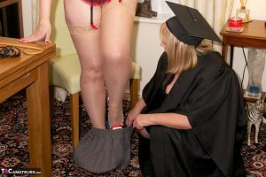Mature amateur Dirty Doctor spanks an older redhead dressed as a schoolgirl