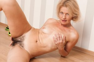 Russian granny Diana Douglas stretching and fingering her hairy muff