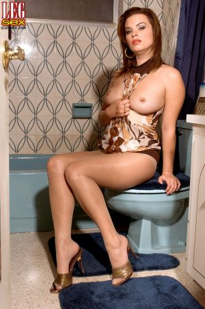 Hot MILF Bailey Brooks shows her great legs while disrobing for a bath