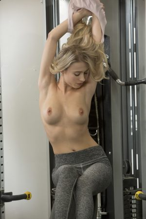 Slim fitness girl Riley Anne strips and flaunts her trimmed muff in the gym
