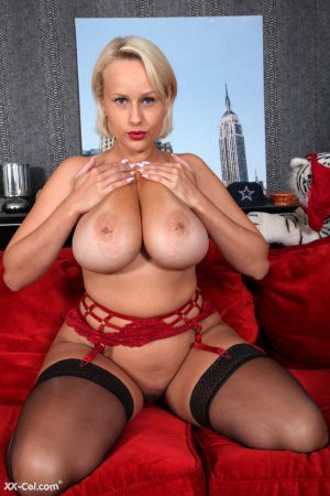 Blonde Czech woman Angel Wicky teasing with her big natural tits in stockings