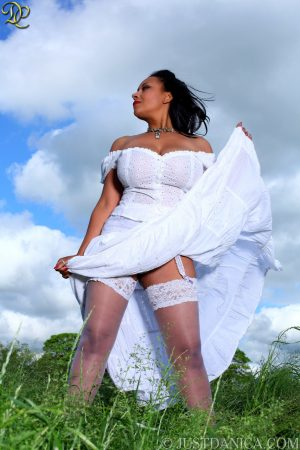 Angelic MILF Danica Collins exposes her big tits in a white dress outdoors
