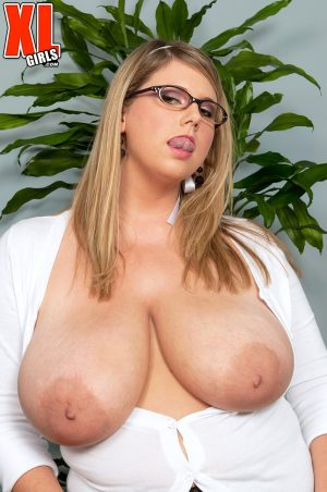 Fat secretary Michelle May toys at her desk while licking big her natural tits