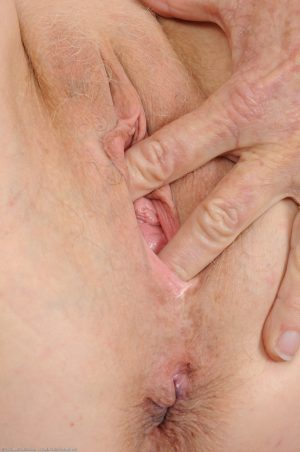 Cute granny Annabelle gets rid of her clothes and fingers her mature holes
