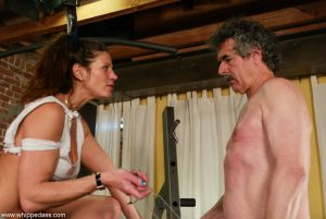 Dominant female Kym Wilde flogs a man in the gym before trampling him