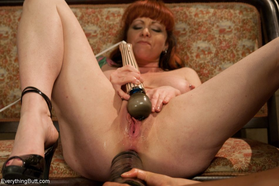 Latina lezdom inserting her foot in Kylie Ireland's sexy asshole