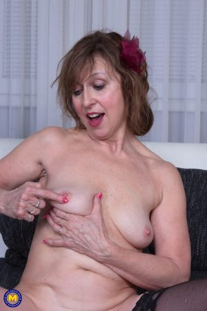 Mature wife Danny removes her red dress and masturbates in the shower